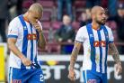 Josh Magennis, left, at the end of the match against Hearts with team-mate Julien Faubert