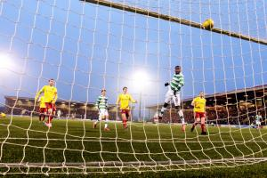 Moussa Dembele turns in Celtic's second goal to help the Premiership leaders reach the fifth round of the Scottish Cup, where they will face Inverness
