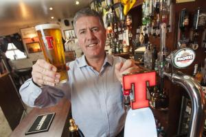 Owner of Ayr's Tam O'Shanter Inn David Cowan shows off the new Tennent's fount at his pub