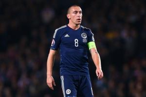 Scott Brown's relationship with Scotland manager Gordon Strachan is one reason behind his game-by-game agreement