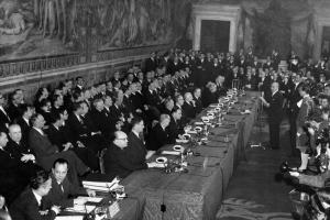 In 1957, then mayor of Rome Umberto Tupini (standing at center right) addressed delegates of six west European nations: France, Germany, Italy, Belgium, The Netherlands and Luxembourg