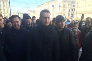 Alexei Navalny, centre, was arrested in Moscow walking to the protest in Pushkin Square