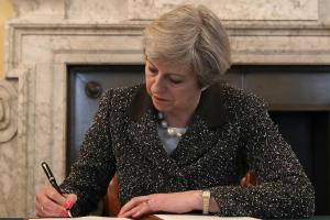 Theresa May signed the letter that will be delivered to Donald Tusk to start the Brexit process. Photograph: Christopher Furlong/Getty