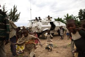Children play next to a UN convoy heading to Rutchuro in DR Congo
