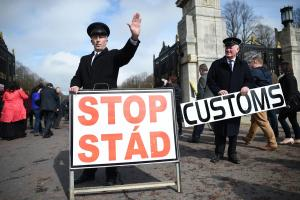 Demonstrators dress as customs officers to illustrate the fears of hard borders in a post-Brexit Ireland