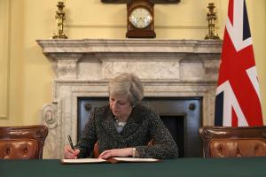 With one stroke of the pen, Theresa May has opened up a constitutional crisis. Photograph: Christopher Furlong/PA