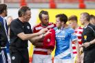 Danny Swanson (blue) was one of the two St Johnstone players to be ordered off. Photograph: Roddy Scott/SNS