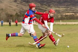 Kingussie's Rory MacGregor, left, moves in on David Falconer of Kinlochshielel. Photograph: Neil G Paterson