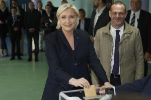 Far-right leader and candidate for the 2017 French presidential election Marine Le Pen casts her vote for the first-round presidential election, while the National Front's Henin-Beaumont's mayor Steeve Briois, right, looks on Photograph: AP Photo/Frank