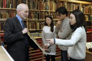 Gang Chen and Keyang Huang, representatives from Nanjing Museum, meet cataloguing programmes manager Iain Fraser as part of a knowledge exchange, with support from interpreter Luyue Wang