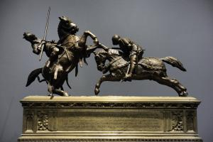 A bronze sculpture by French-Dutch artist Alfred de Nieuwerkerke which portrays the death of the Duke of Clarence, brother of the English King Henry V, at Baugé
