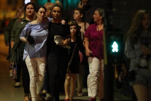 Police escort members of the public from the Manchester Arena following the attack.  Photograph: Getty