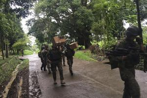 Philippine troops arrive at their barracks to reinforce fellow troops following the siege