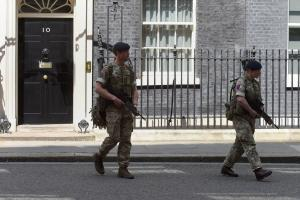 Members of the army outside 10 Downing Street, London, after Scotland Yard announced armed troops would guard 'key locations'