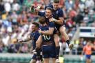 Scotland celebrate at the final whistle after defeating England during the HSBC London Sevens cup final at Twickenham Stadium on May 21