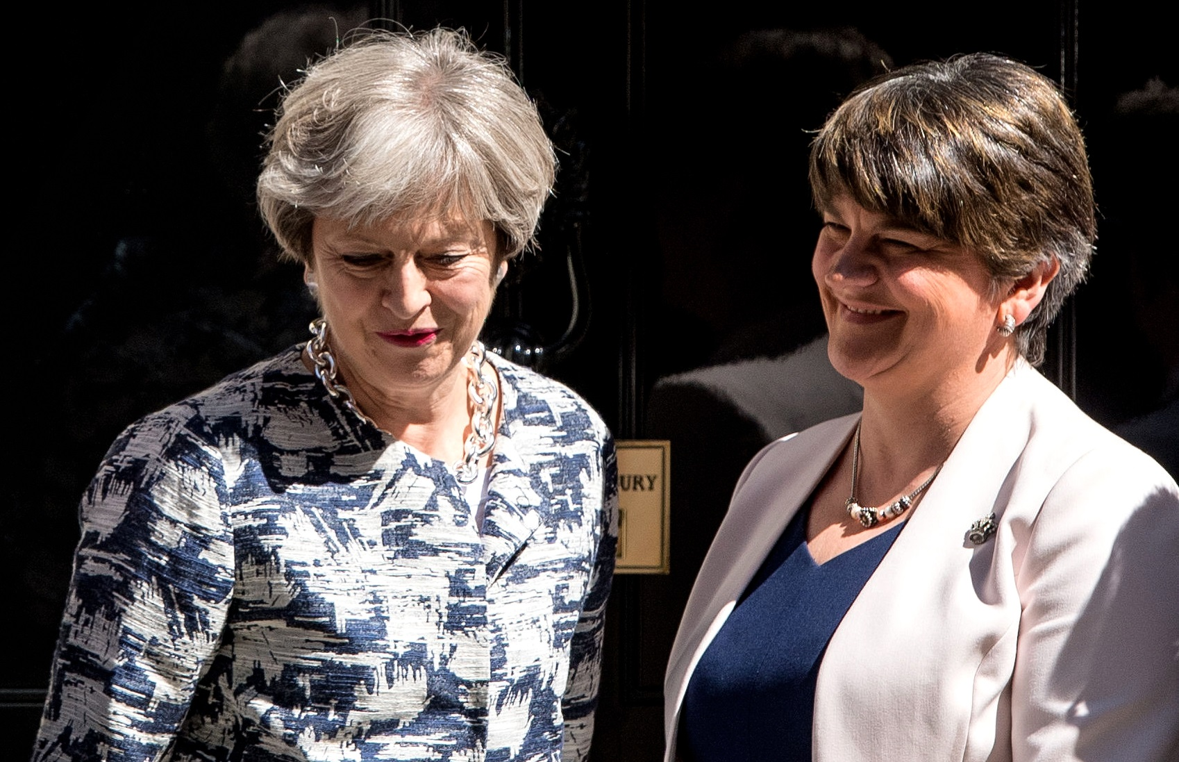 DUP leader Arlene Foster and Theresa May after agreeing the deal on key Commons votes