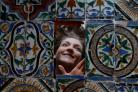 Ellen Smith of Lyon & Turnbull with some of the more than 200 rare 16th century Spanish church tiles found in an Edinburgh basement