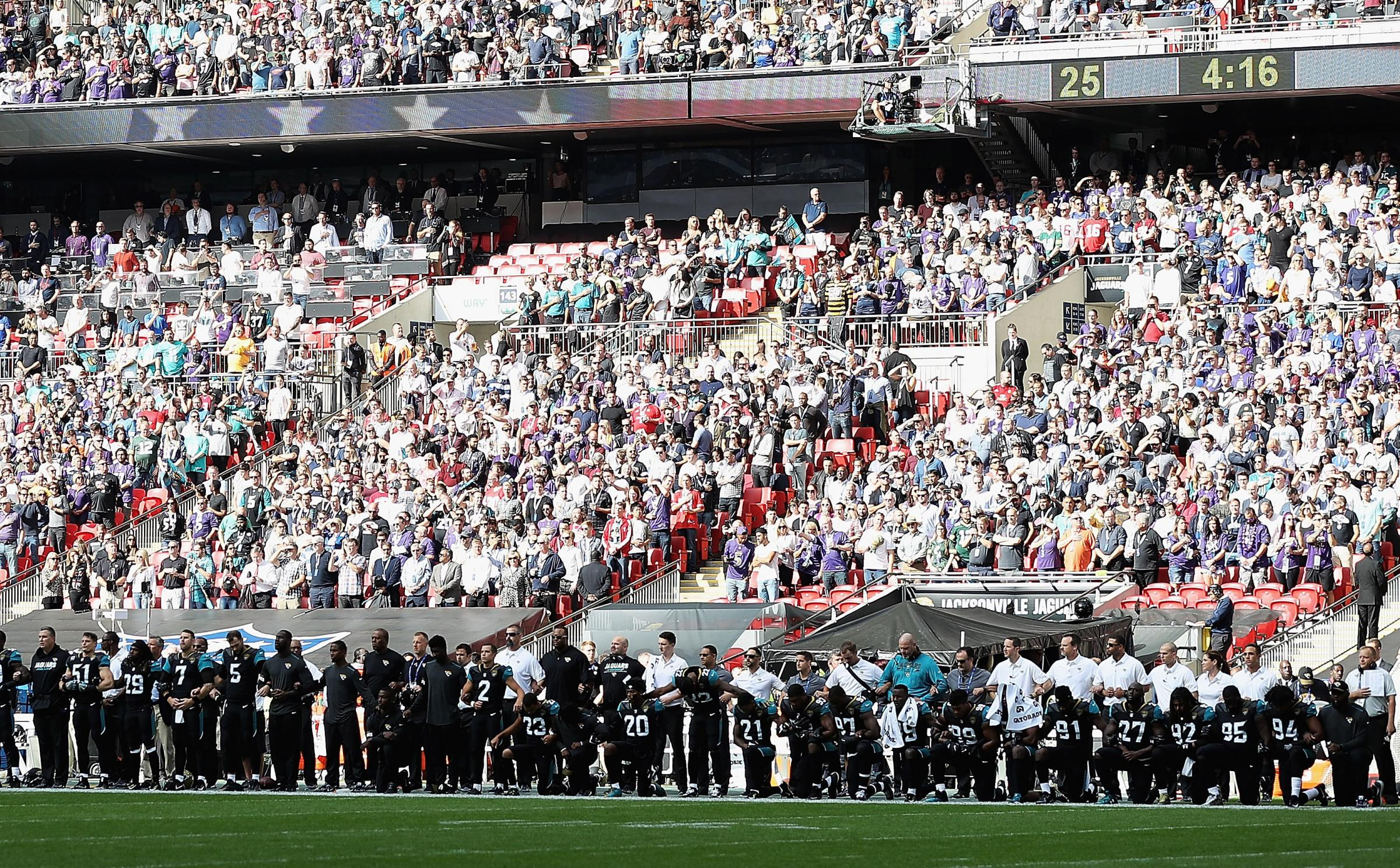 Jacksonville Jaguar players protest during the national anthem at Wembley during the NFL International Series match against Baltimore Ravens Photograph: Matthew Lewis/Getty