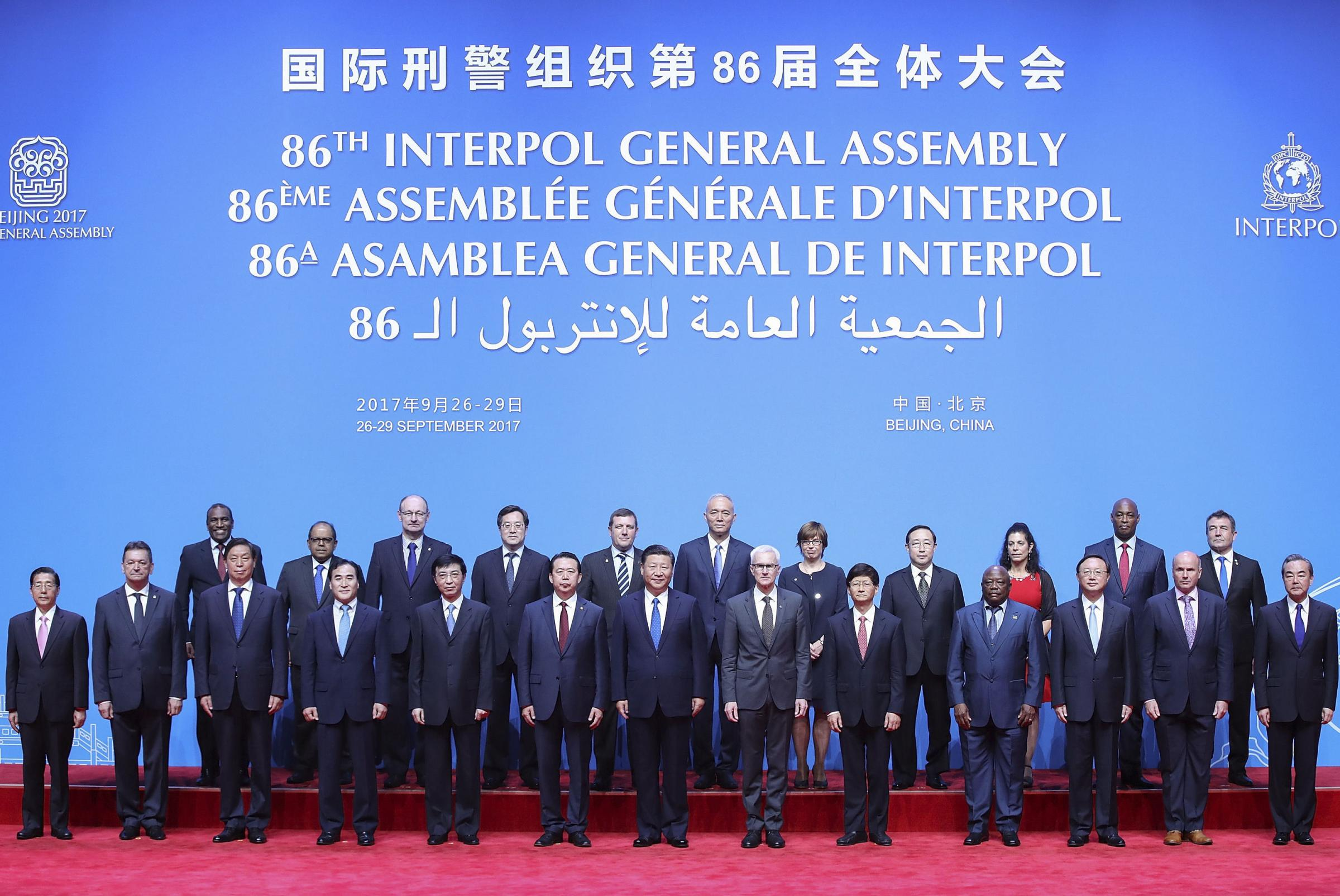 Chinese President Xi Jinping, front centre, poses with, among others, Interpol officials before the Interpol General Assembly. Photograph: AP