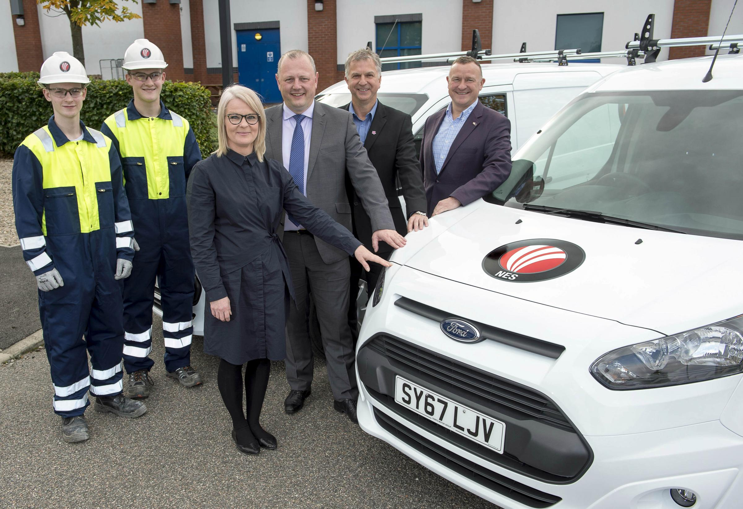 From left: apprentices Tyler Whitty and Kyle Livingstone; Kirsty Bulloch, NES business development manager; Kenny Duncan, NES managing director; Keith Paterson, NES director; and SNP MP Drew Hendry