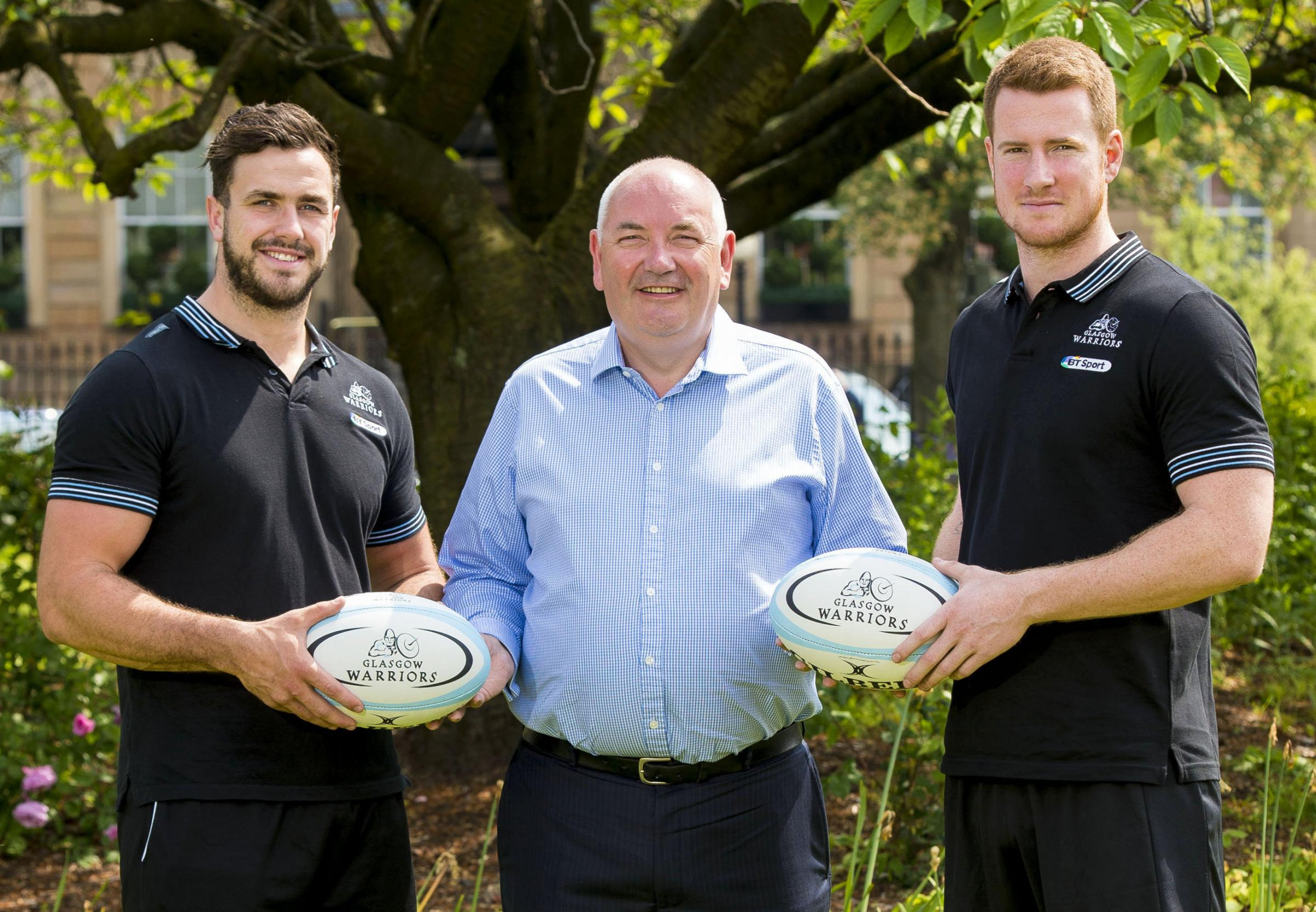 Warriors players Alex Dunbar, left, and Rory Clegg with Primestaff chief executive Danny McIntyre