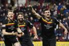 Partick Thistle's Kris Doolan, right, celebrates his equaliser