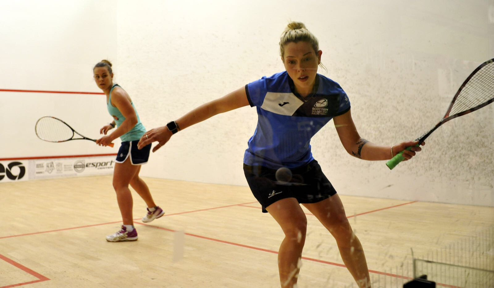 Lisa Aitken, right, is one of Scotland's top female squash players