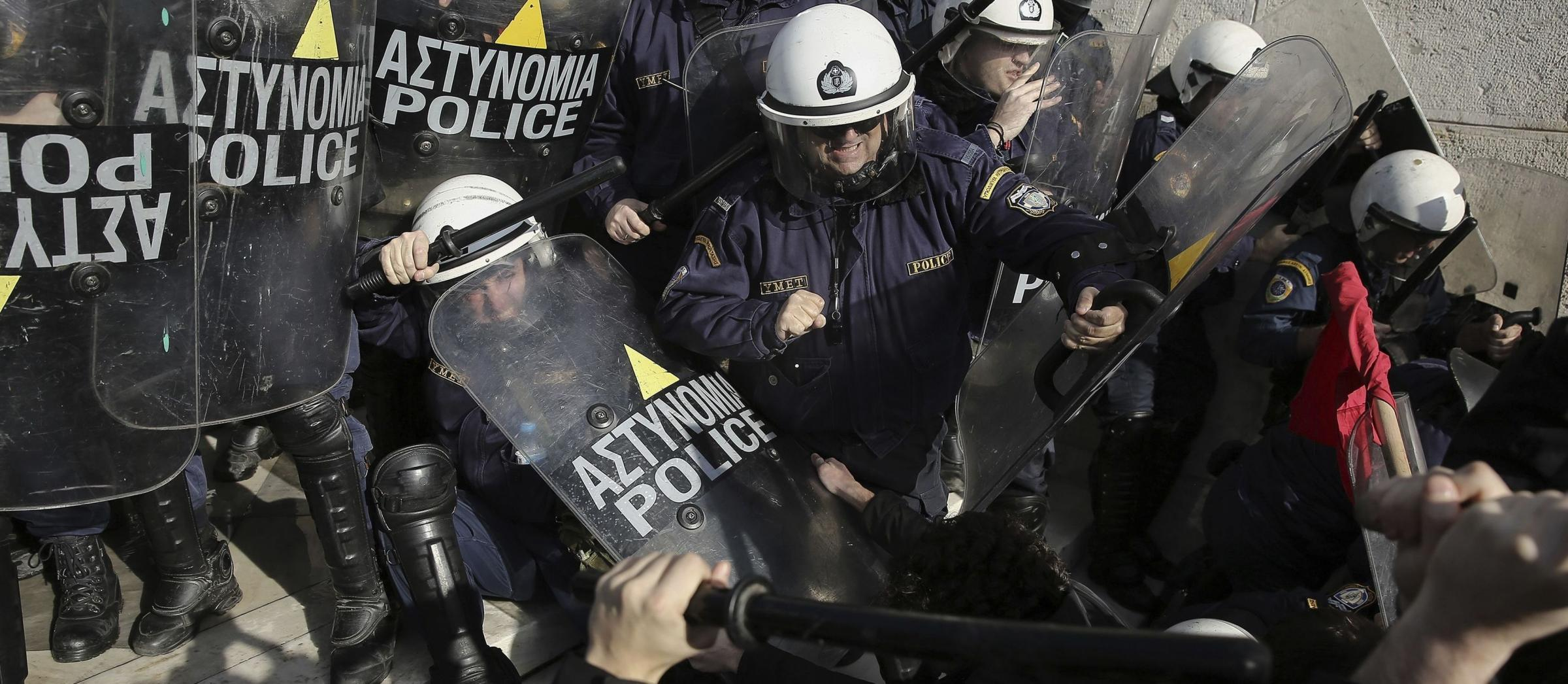 Protesters tussled with police on the parliament steps of the capital. Photograph: AP