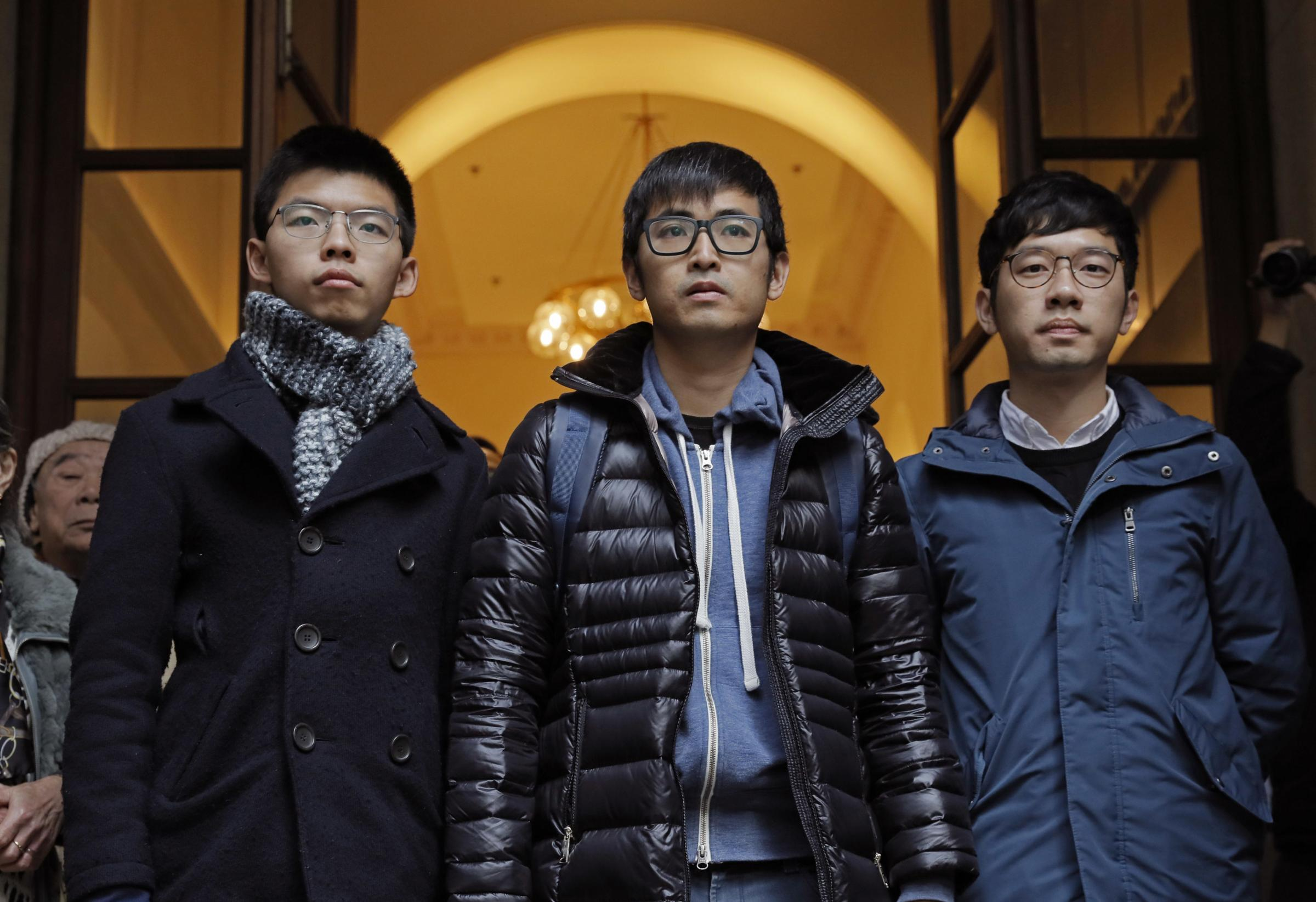 Joshua Wong, Nathan Law and Alex Chow. Photograph: AP