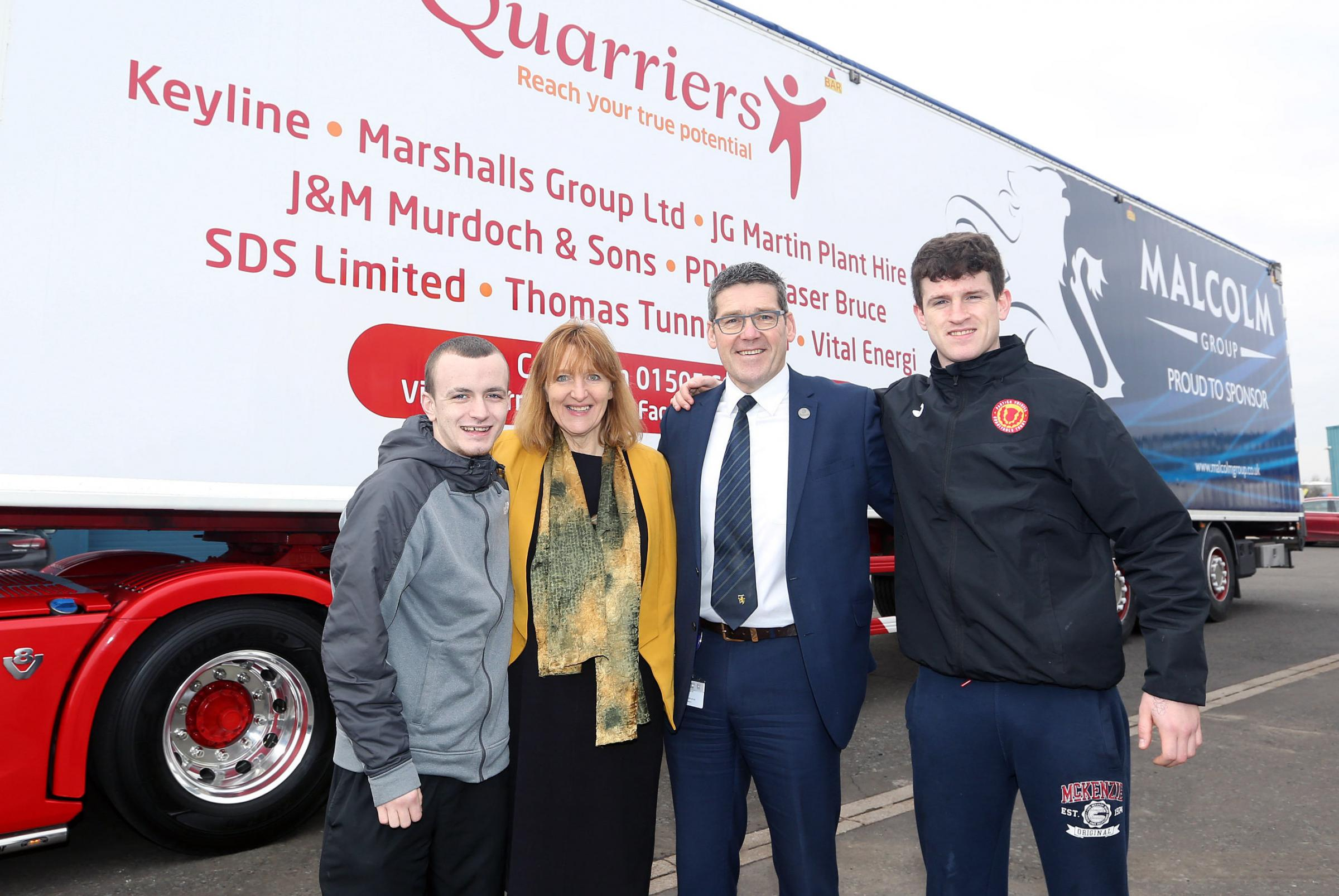 Andrew Malcolm and Alice Harper with two young people that Quarriers has supported