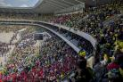 Thousands of mourners packed the 40,000-seat Orlando Stadium in Soweto