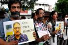 A silent protest was held for Shujaat Bukhari. Photograph: Getty