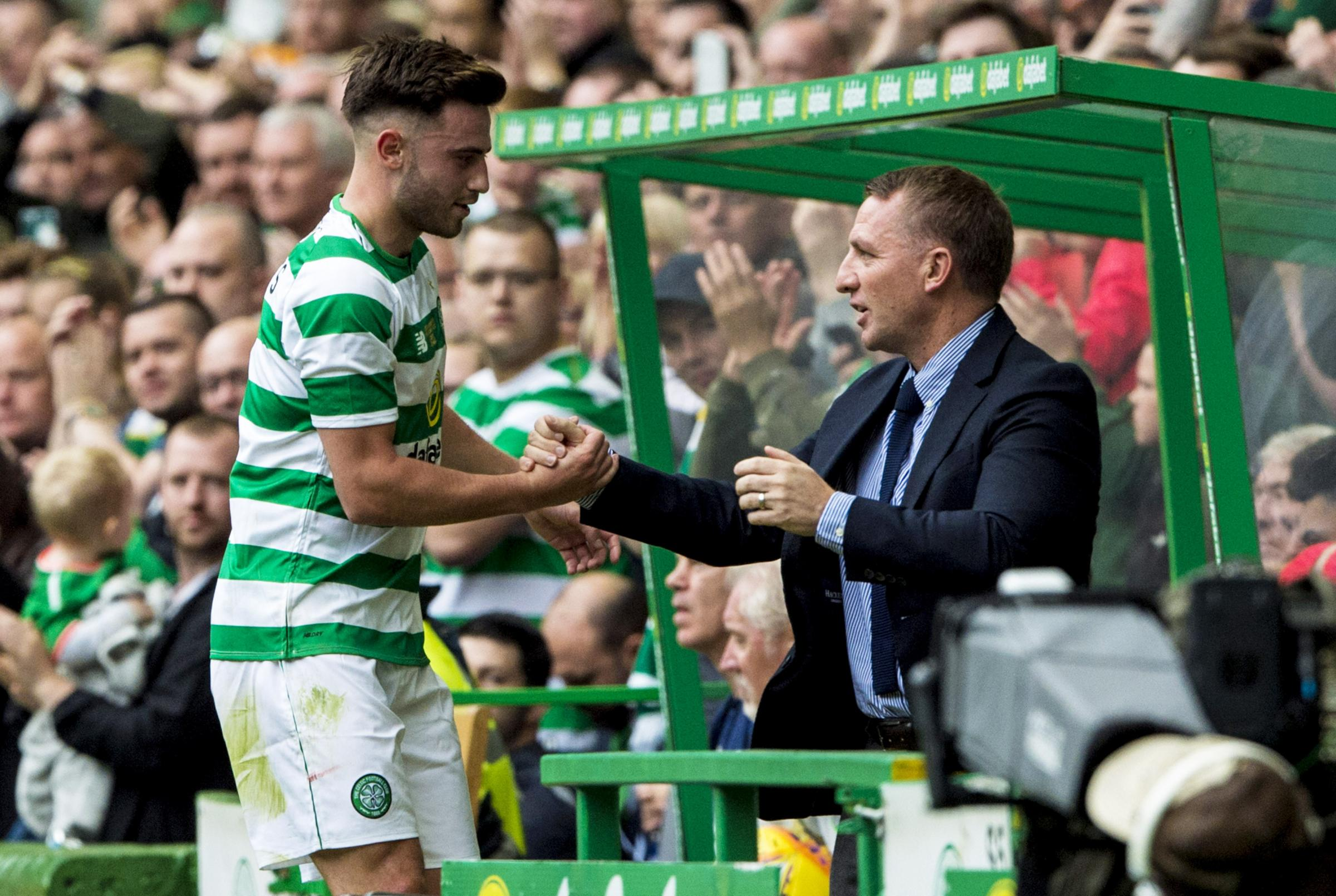 Patrick Roberts, left, shakes hands with Celtic manager Brendan Rodgers as he is substituted last season.