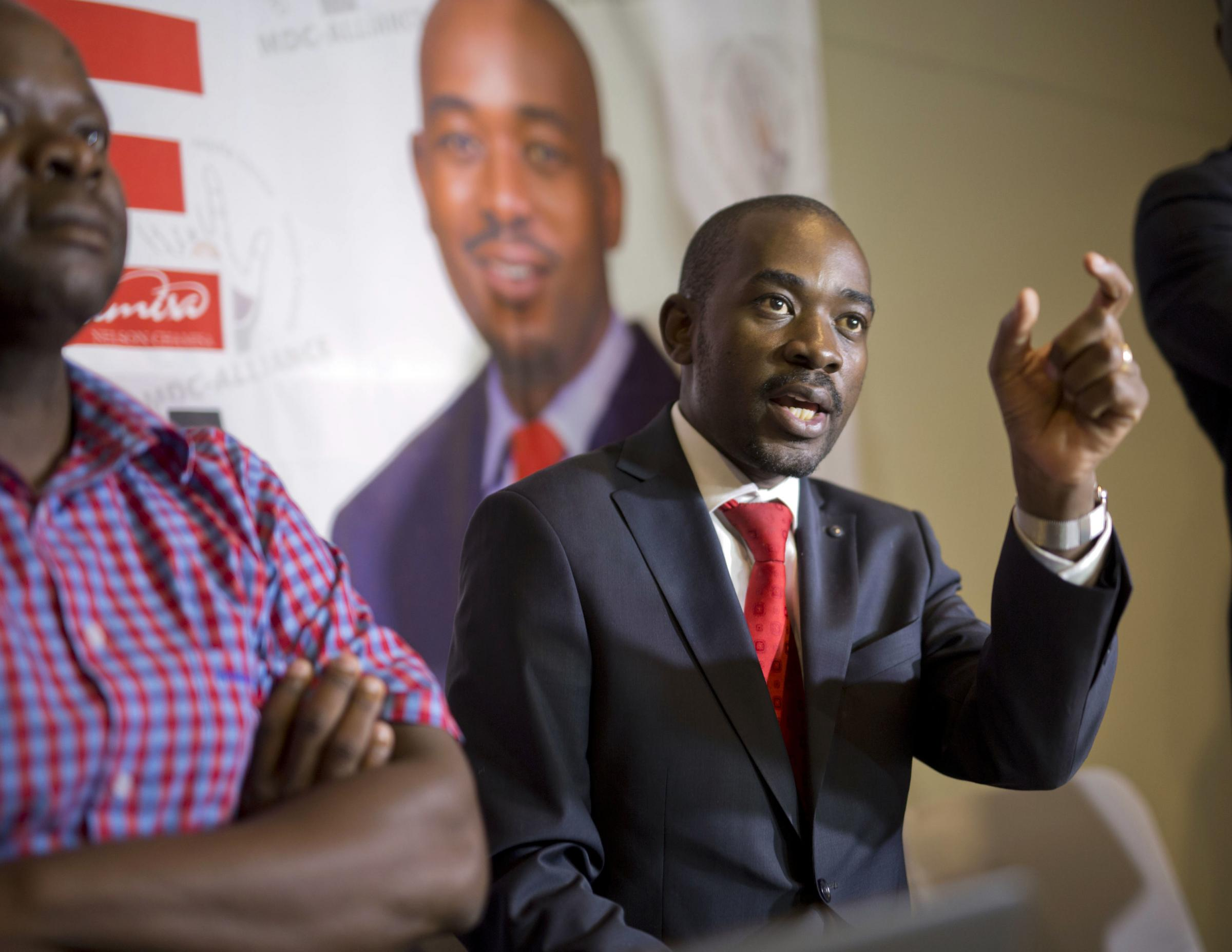 Opposition leader Nelson Chamisa says police have raided opposition headquarters in the capital and seized computers