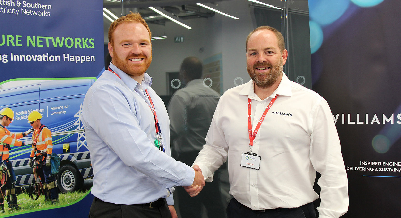 SSEN's Ben Pirie,left, and Williams Advanced Engineering's Stu Olden shake on the agreement to develop live working robotic specification